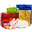 Two white rabbits with gifts — Stock Photo