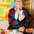 Elderly woman with credit card — Stock Photo