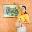 Pregnant womdecorating her room — Stock Photo #5153612