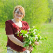 Stock Photo: Woman in the spring garden