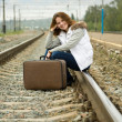 Girl sitting on rail - Stock Photo