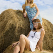 Pretty girls on hay bale — Stock Photo #5154961