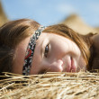 Girl laying on straw — Stock Photo #5154979