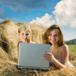 Girls relaxing with laptop — Stock Photo #5155024