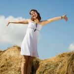 Girl standing on hay — Stock Photo #5155030