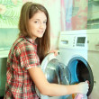 Teenager girl doing laundry — Stock Photo