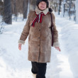 Woman is walking at winter park — Stock Photo