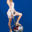 Foto Stock: Sexual girl with vacuum cleaner