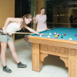Women playing billiards — Stock Photo