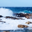 Sea wave breaking against coast  rock — Stock Photo