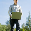 Man standing   with laptop — Stock Photo