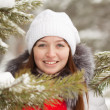 Girl in wintry pine forest — Stock Photo