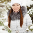 Woman near pine tree in winter — Stock Photo