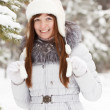 Girl in wintry pine forest — Stock Photo #5156420
