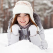 Woman lying on the snow — Stock Photo #5156421
