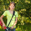Girl works with grass-cutter — Stock Photo #5156565