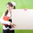 Schoolgirl holds blank canvas — Stock Photo #5157029