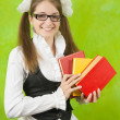 Schoolgirl in glasses with books — Stock Photo #5157059
