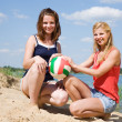 Girls with volleyball on beach — Stock Photo