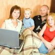 Royalty-Free Stock Photo: Family on sofa with laptop