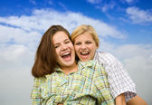 Happy girls together against sky — Stock Photo