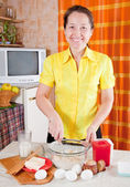 Woman making dough — Stock Photo