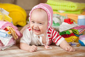 Baby girl with children's clothes — Fotografia Stock