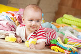 Happy baby with baby's wear — Stock Photo
