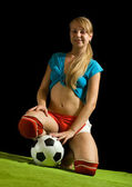 Sexy female soccer fan — Stock Photo