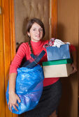 Woman putting out the garbage — Stock Photo