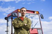 Farmer with tracto — Stock Photo