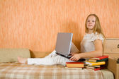 Girl with laptop and books — Stock Photo