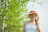 Girl in hat near birch — Stock Photo