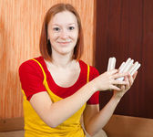Girl holding an energy saving light bulbs — Stock Photo