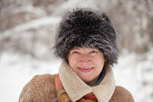 Of mature woman in wintry forest — Stock Photo
