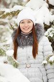 Woman near pine tree in winter — Stock Photo