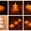 Different candles on a bamboo carpet - Stock Photo