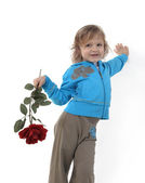 Little girl with a red rose — Stock Photo