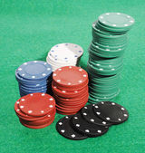 Casino chips on a green table — Stock Photo
