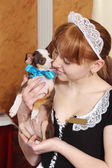 Female waiter with a small dog — Stock Photo