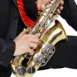 Men's long sitting with sax - Stock Photo