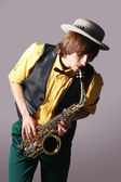 Man with a sax musical instrument — Stock fotografie