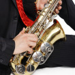 Men's long sitting with sax — Stock Photo