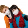 Stock Photo: Man embraces a woman wearing masks, flu
