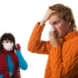 Man influenza patients, a woman stands behind a mask — Stock Photo #3913559