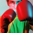 Doctor in red boxing gloves fighting against influenza — Stock Photo