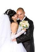 Bride to the bridegroom on a white — Stock Photo