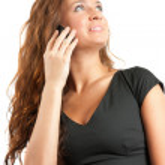 Pretty girl speak by phone — Stock Photo