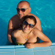 Young Couple Swimming In Pool — Stock Photo #3168425