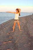 Young woman doing yoga on beach — Stock Photo